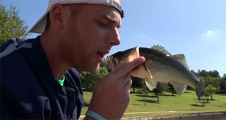 a guy kissing a fish, a stereotype of fishing