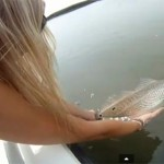 A blonde Caresses Fish