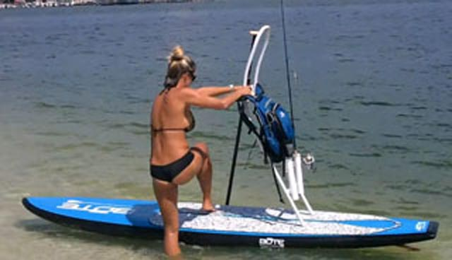 a blonde paddle fishing